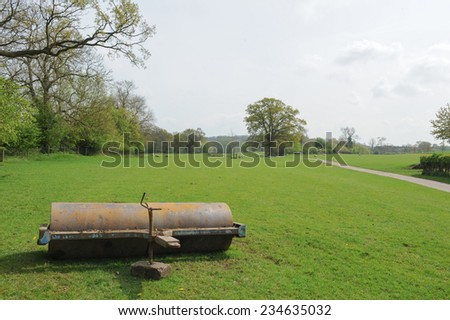 Abandoned Farm Machinery on Cutlers Farm near Stratford upon Avon, Warwickshire, England, UK - stock photo