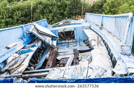 Abandoned fishing boat on beach at Alonissos, Greece - stock photo