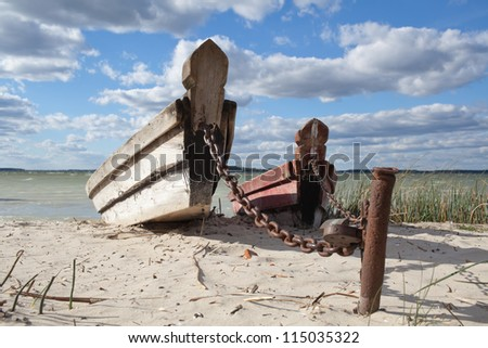 Abandoned fishing boats on the beach - stock photo