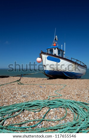 abandoned fishing trawler on beach. ship on english south coast in dungeness - stock photo