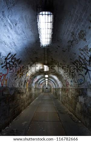 abandoned graffiti tunnel - stock photo