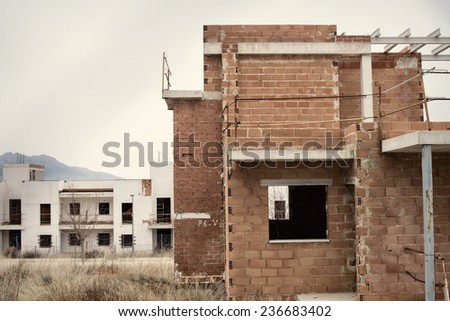 Abandoned half finished housing project, a result of the real estate bubble - stock photo