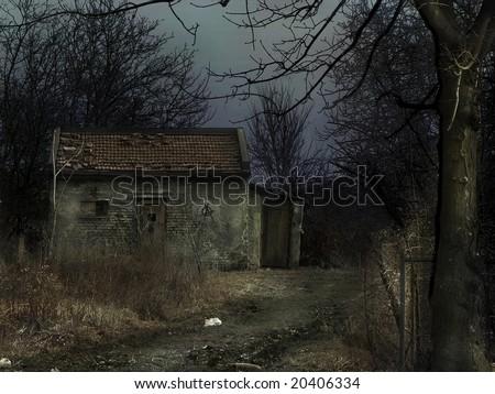 abandoned house in dark woods - stock photo