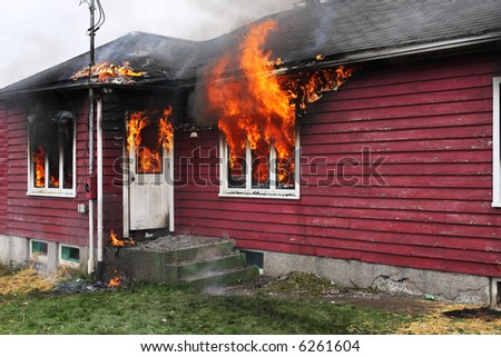 Abandoned house in flame , fire trough the windows - stock photo
