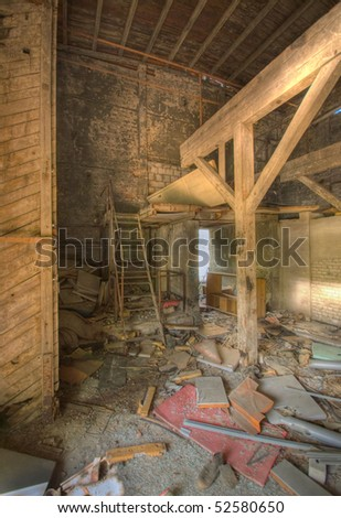 Abandoned house interior full of garbage - stock photo