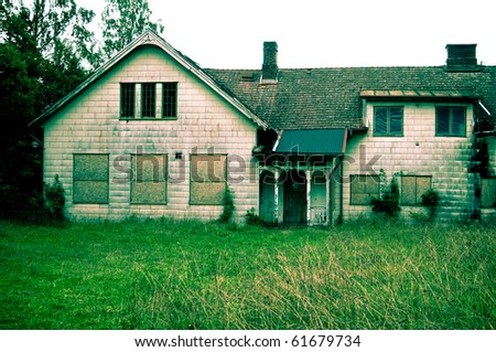 Abandoned house with asbestos cement sheeting. Creative coloring of image in green hue - stock photo