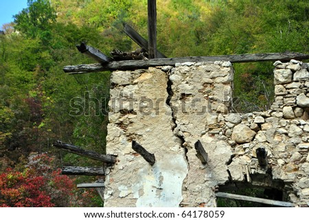 abandoned house with background larch - stock photo