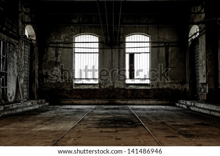 Abandoned industrial interior with bright light - stock photo