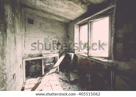 Abandoned interior in ruins of military settlement. City of Skrunda in Latvia - vintage film effect