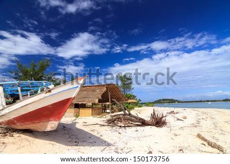 Abandoned local fishing boat. Gili Meno, Lombok, Indonesia - stock photo