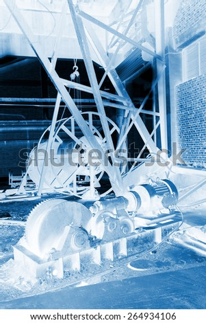 abandoned mechanical equipment in a factory, closeup of photo
