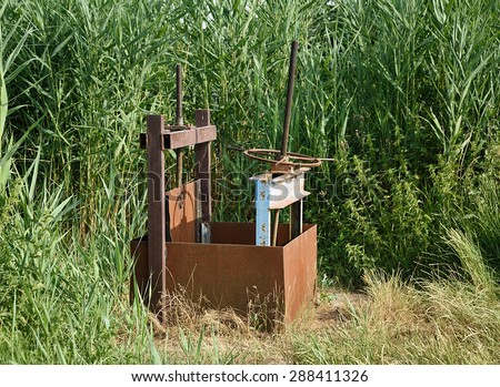 Abandoned metal sluice in the nature - stock photo