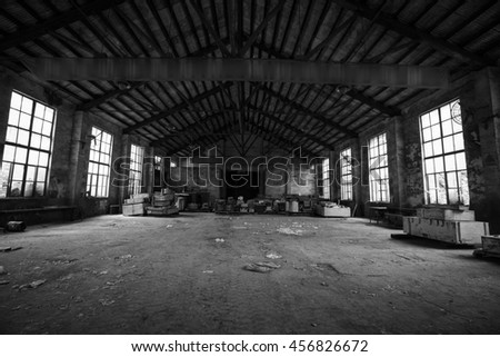 Abandoned metallurgical factory interior and building waiting for a demolition.Black & white style.