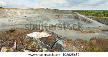 Abandoned mine - damaged landscape after ore mining. - stock photo