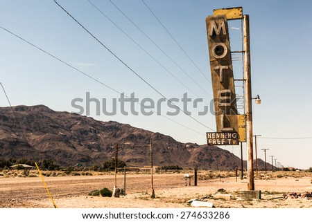 Abandoned Motel Sign in the Deseret in California - stock photo