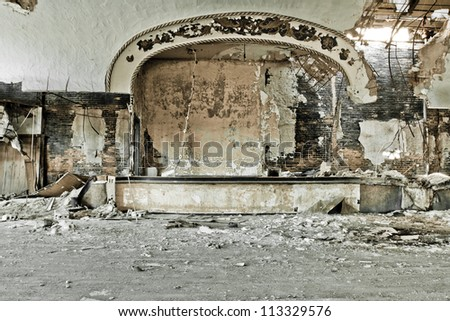 Abandoned music theater ballroom in Detroit Michigan. It has burned and it's once beautiful facade is crumbling away. - stock photo