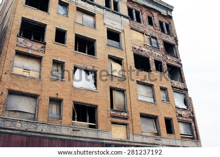 Abandoned office building in Detroit, Michigan. The building has been stripped of anything of value by looters.   - stock photo