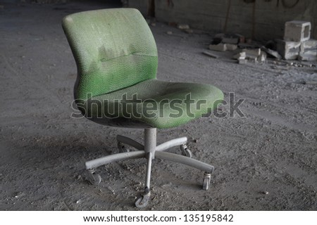 Abandoned office chair in an abandoned building, in light HDR processing
