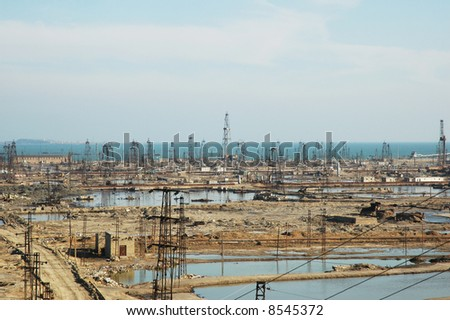 Abandoned oil derricks near Baku, Azerbaijan - stock photo