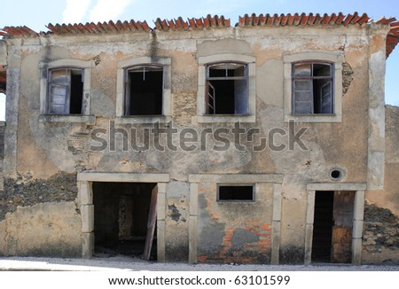 Abandoned old building without doors and windows. - stock photo