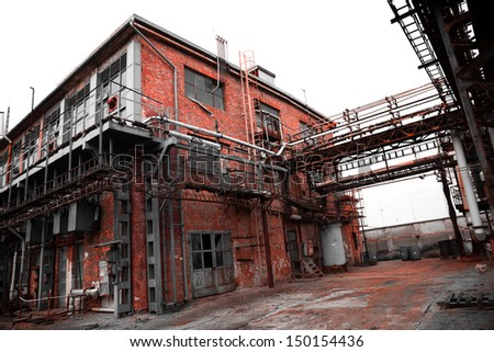 abandoned old chemical factory - stock photo