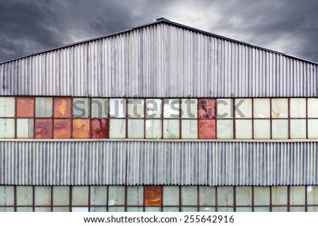 Abandoned old factory building with broken window - stock photo