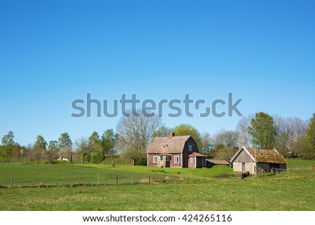 Abandoned old farm in rural landscape
