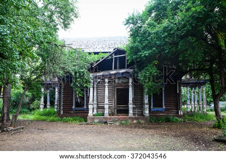Abandoned old house in the woods - stock photo