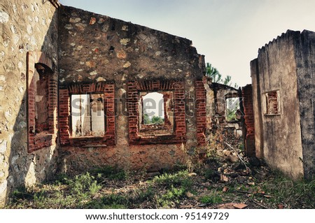 abandoned old house, old windows on old dirty wall - stock photo