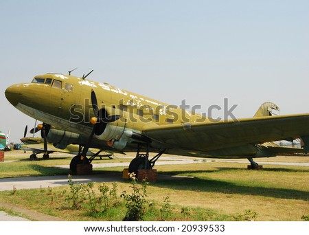 Abandoned old military transport airplane in green color