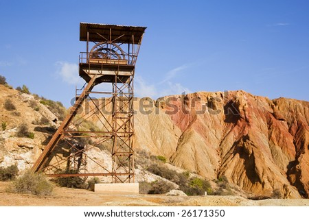 Abandoned old mining machinery in desert. - stock photo