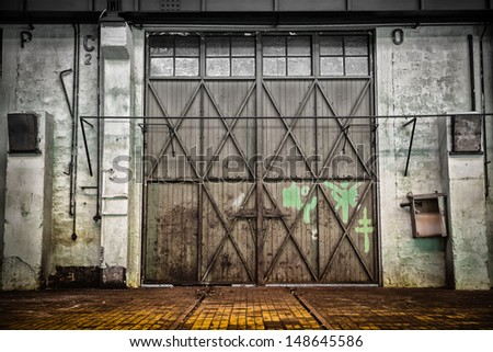 abandoned old vehicle repair station - stock photo