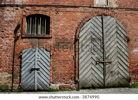 Abandoned old warehouse building facade - stock photo