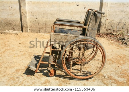 Abandoned old wheelchair - stock photo