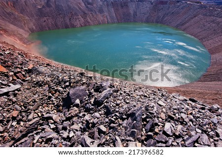 abandoned or flooded pit mining of iron ore - stock photo
