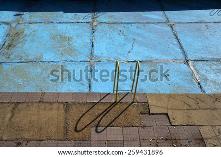 Abandoned outdoor swimming pool - stock photo