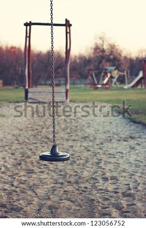 Abandoned playground at down - stock photo