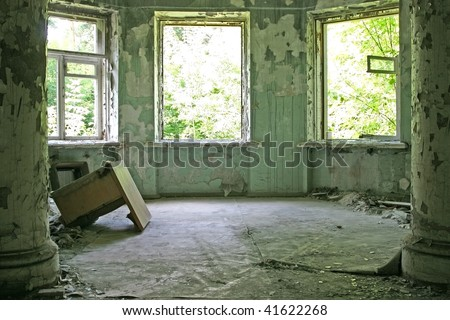 abandoned room with columns - stock photo