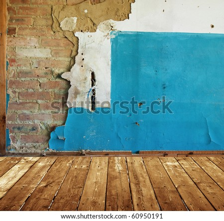 abandoned room with old painted brick wall - stock photo