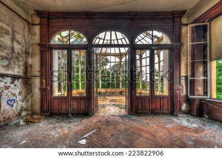 Abandoned room with view through beautiful broken conservatory, HDR - stock photo