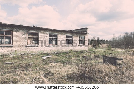 Abandoned ruins of military settlement. City of Skrunda in Latvia - vintage film effect