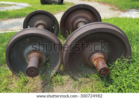 Abandoned rusty train two wheels on the grass