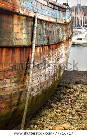 Abandoned ship in harbor, high density range image - stock photo
