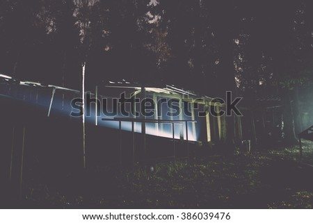 abandoned sports track at night in Latvia - vintage effect
