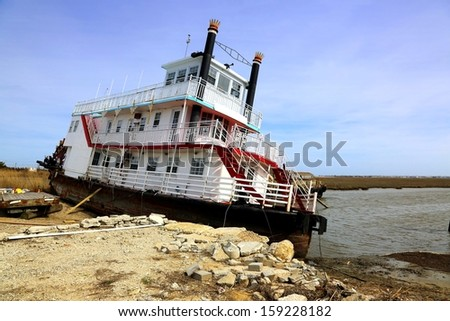 abandoned steam boat - stock photo