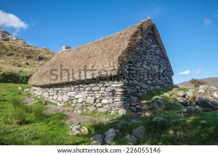 Abandoned Stone Thatched Cottage - stock photo