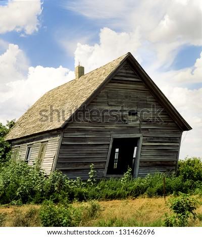 Abandoned territorial era one room schoolhouse in rural Oklahoma. - stock photo