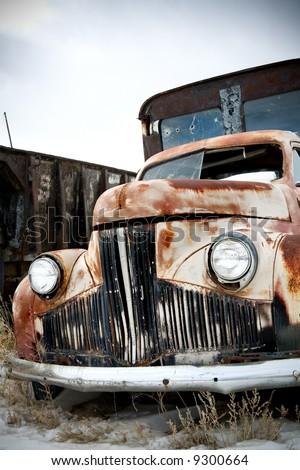 abandoned truck in rural wyoming junkyard - stock photo