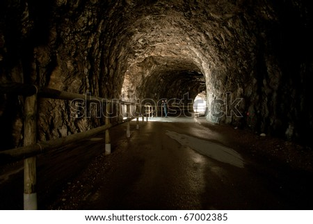 abandoned tunnel in the rock only pedestrian - stock photo