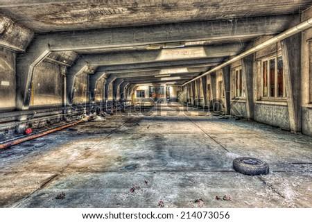 Abandoned underground parking garage, HDR - stock photo